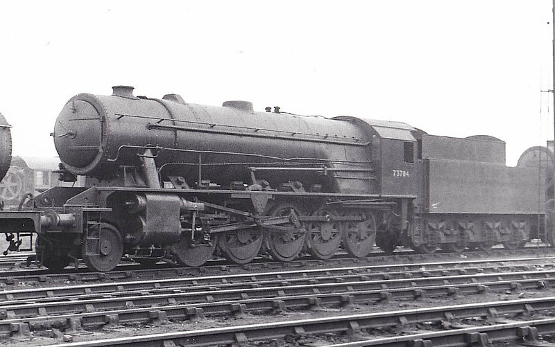 73784 - WD Class 8F 2-10-0 - built 06/45 by North British Loco Co. as WD No.73784 - 1948 to BR No.90760 - 05/62 withdrawn from 66B Motherwell - seen here at Feltham, 03/48, in transit I guess, to Scotland for BR use.<br /> 150 WD 2-10-0's were built during WW2, basically similar to the much more numerous 2-8-0 but with a lighter axle loading for secondary routes. All were built by the North British Loco Co. and they were sent to all theatres of war. They were not popular in Britain due to their long wheelbase and only 25 passed to BR after War, all for use in Scotland. 108 became NS Class 5000, 16 to Greek State Railways and 4 to Syria. Two engines were retained by the WD and based at the Longmoor Military Railway.