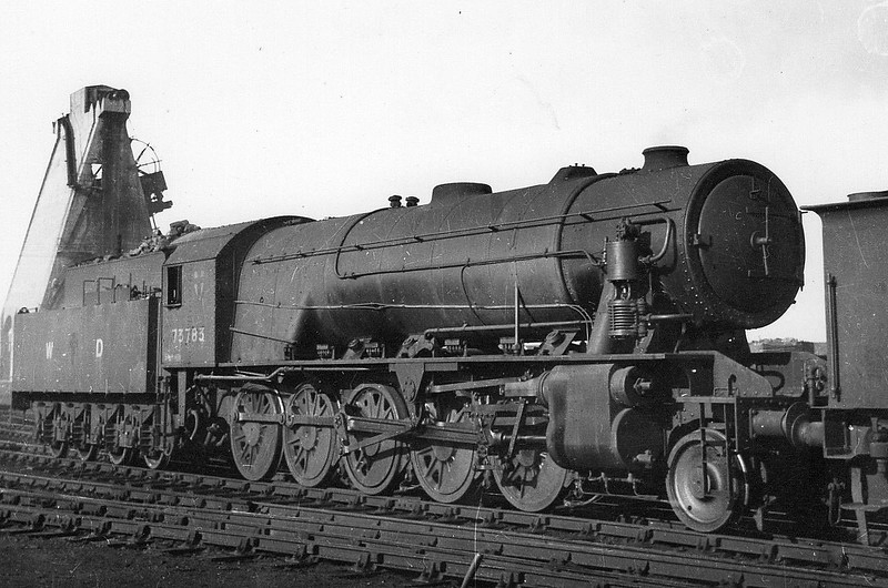 73783 - WD Class 8F 2-10-0 - built 06/45 by North British Loco Co. as WD No.73784 - 1948 to BR No.90759 - 12/62 withdrawn from 65F Grangemouth - seen here at March in 1945.<br /> 150 WD 2-10-0's were built during WW2, basically similar to the much more numerous 2-8-0 but with a lighter axle loading for secondary routes. All were built by the North British Loco Co. and they were sent to all theatres of war. They were not popular in Britain due to their long wheelbase and only 25 passed to BR after War, all for use in Scotland. 108 became NS Class 5000, 16 to Greek State Railways and 4 to Syria. Two engines were retained by the WD and based at the Longmoor Military Railway.