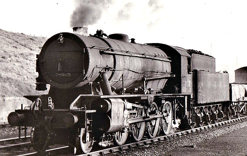 "78565 - WD Class 8F 2-8-0 - built 09/44 by North British Loco Co. as WD No.78565 - 03/47 to LNER No.3088, 08/50 to BR No.90088 - 07/65 withdrawn from 40E Langwith Junction - seen here at Potters Bar, 1947.<br /> The War Department ""Austerity"" 2-8-0 is a type of heavy freight steam locomotive that was introduced in 1943 for war service. A total of 935 were built, making this one of the most-produced classes of British steam locomotive. The locomotive was a redesigned Stanier 8F, built for economy rather than longevity, 545 were built by the North British Loco Co. and the other 390 by the Vulcan Foundry. The whole class but for three served in Europe after D-Day and many returned to Britain postwar. 200 were sold to the LNER as Class O7 and a further 533 were sold to the BTC. These 733 became British Railways Class WD in 1948, numbered 90000 to 90732. In 1946, 12 were sold to the Kowloon - Canton Railway, 184 went to Holland as NS Class 4300 and 1 went to USATC. The WD retained 5 engines, scrapped 3 and the other two served on the Longmoor Military Railway."