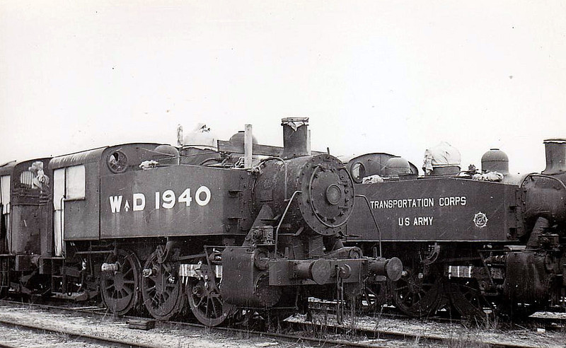 1940 - Class 'USA' 0-6-0T - seen here somewhere presumably in Southern England en route to Europe in 1944/45 - 382 of these small but powerful tank engines were built by 3 US engine builders from 1942 and ended up all over postwar Europe, many still in service until quite recently. Around 20 were also sent to China. Note that these two examples are not exactly similar.
