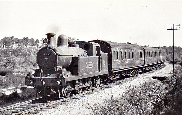2253 - Hookham NSR Class New L 3F 0-6-2T - built 06/09 by Stoke Works as NSR No.158 - 1923 to LMS No.2253 - 03/36 withdrawn, sold to Longmoor Military Railway - seen here near Weaversdown Halt - note the spotlight mounted in front of the chimney.