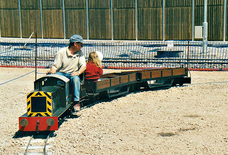 ( 92) - Whitemoor Open Day, May 25th, 2004 - My granddaughter is the only passenger on this train powered by a Dunhams Wood Light Railway Drewry 0-6-0 shunter.