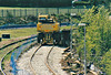 (82) - A road/rail JCB sits at the end of the now ballasted headshunt, 25/04/04.