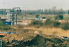 ( 75) - The skeleton of the control tower looks complete, 11/04/04. The tracklaying train is behind the bushes.