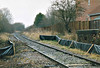 (  7) - A view down the abandoned Wisbech Branch, 23/11/03. I don't really know what these little fences were for - they're not very substantial. Note the WW2 pillbox on the right, built to defend Wisbech from rail-mounted Nazi invaders.