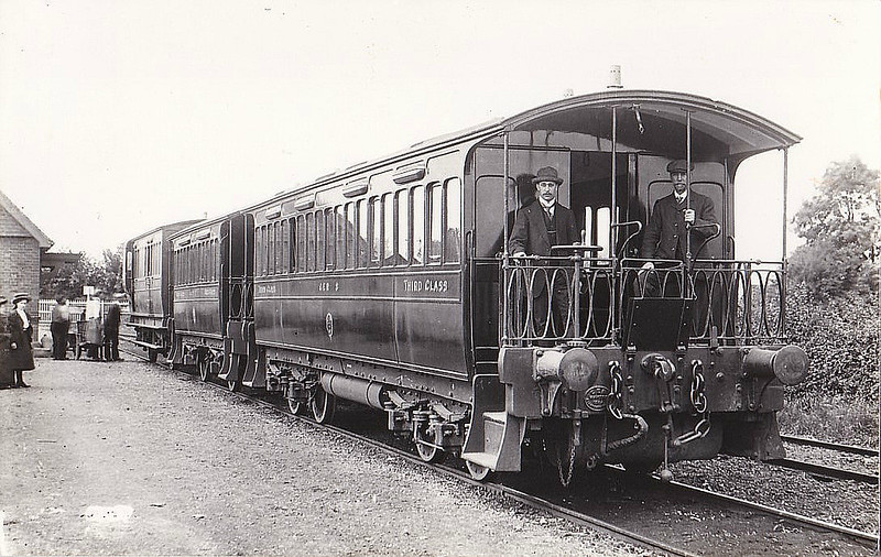The Great Eastern had coaching stock specially built for the Tramway, low slung and with ground level steps due to lack of platforms. The two bogie coaches were built in 1884, No.8, a Third Open (nearest the camera), No.7, a Composite (in the middle) and the Guard's Van was No.16. When passenger services were withdrawn in 1927, the coaches went to Kelvedon & Tollesbury Light Railway where they survived into BR ownership. Seen here at Upwell in about 1910.