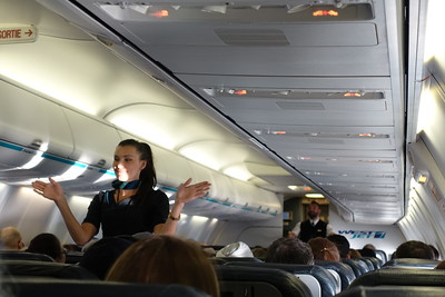 Our hostess is saying there will be free booze  for everyone sitting from the last rows up to here. Actually all passengers got free booze on this flight.
