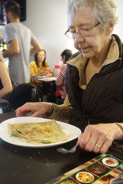 Sharon may be having the spinach and walnut crepe with goat  cheese.