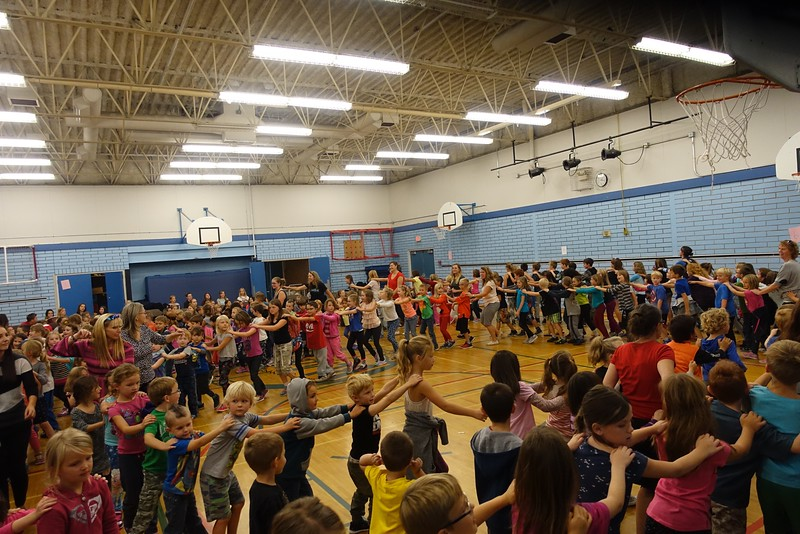 A line dancing to the beat of the drummers.