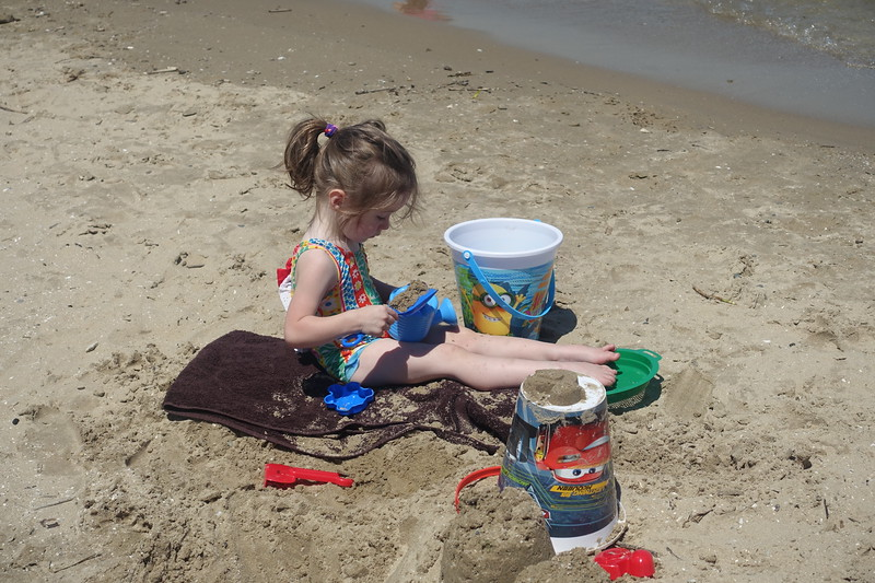 Over time Trinity may learn to enjoy playing in the water, but for now, playing in the sand is tons less stressful.