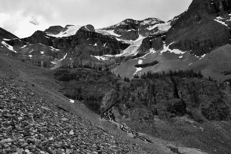 """My lunch-seating spot is amongst the trees sitting atop the hump on the left-hand side.<br /> <br /> My first time up in this basin was August 1997 and again in 2007.  Both times before I made the steep trek up to the tip of the glacier.  Today, it's """"been there done that.""""<br /> <br /> On my way down I'll emerge from the trees on the right side of the plateau and continue along the trail on the other side of the basin."""