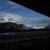 From the hostel, I made the twenty minute drive east to Banff.<br /> <br /> While walking the boardwalk along the Marsh Loop Trail, I stopped and made this mountain range photograph between fence railings.