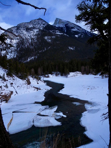 Mt Rundle over-looks a portion of the Bow River as it flows away from Bow Falls, in Banff, heading towards Calgary.