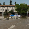 Compare this photo to yesterday's police car picture.  The water level was a tad higher than this when the officer left his vehicle to knock on doors.