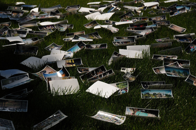 There were a few anxious moments when the breeze almost kicked into gust mode, creating thoughts of chasing images across the neighbourhood's front lawns. The pictures did curl up while drying, so when totally dry, we stacked them in piles of fifty weighing the pile down with books to flatten them out again.