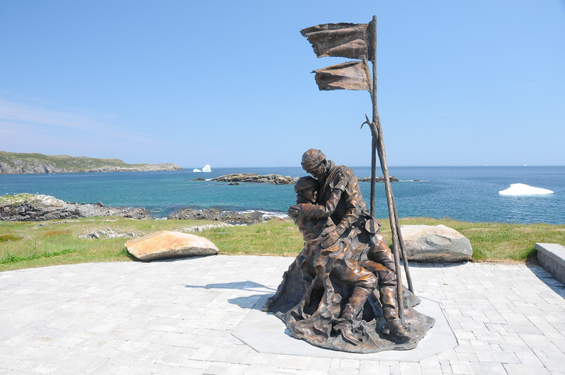 This statue is a memorial for the fisherman of Elliston who lost their lives while at sea.  In particular, it commemorates the story of 115 sailors who froze to death when they became stranded on an ice sheet while hunting seals.  The story begins with a sixteen year old boy begging his father to take him along for the hunt, which was strongly apposed by his mother.  She eventually relented to her son's wishes, and the father and son set off with the other fisherman to hunt seals.   The father and son were amongst the fisherman who died.