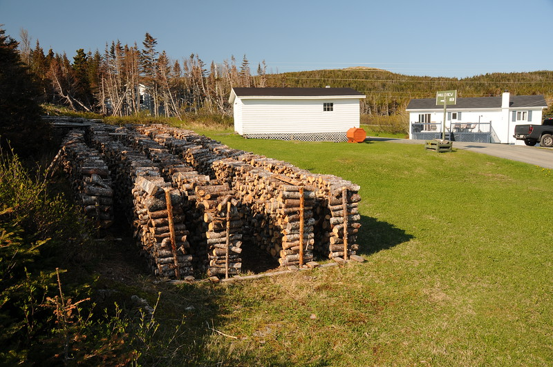 And then re-stacked in the yard, waiting for the colder months of the year.