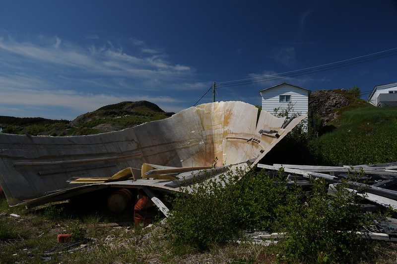 Donna and Keith had decided they were going over to  Fort Point lighthouse in Trinity harbour for some whale watching, while Sharon and I had decided to meander around the town of Trinity. <br /> <br /> We pulled into an empty lot next to this discarded hull of a fibreglass fishing boat, then toured the town on foot.