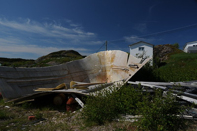 Donna and Keith had decided they were going over to  Fort Point lighthouse in Trinity harbour for some whale watching, while Sharon and I had decided to meander around the town of Trinity.   We pulled into an empty lot next to this discarded hull of a fibreglass fishing boat, then toured the town on foot.
