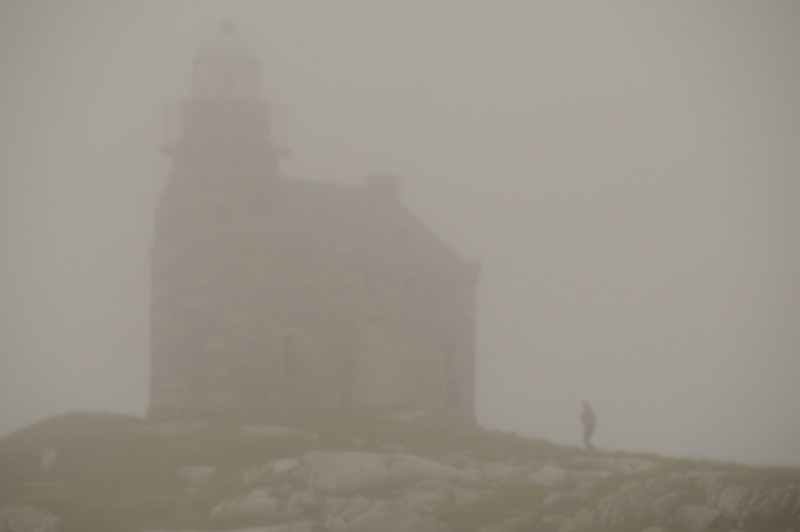 As I begin to head down myself, I take one last look back towards the lighthouse, only to see it almost completely engulfed in fog.