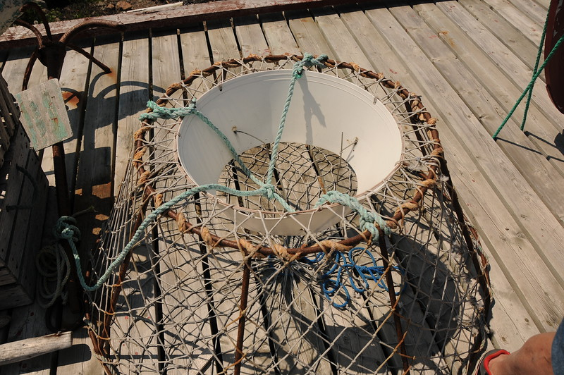 A crab pot for catching crabs.  I am told this could also be a lobster trap.  <br /> So one could also call this a crustacean trap I guess.
