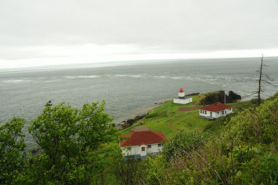 As I started down from the parking lot, this view of the cape came into view through the foreground trees.  What you see are the   light keeper's guest house (lower centre), the restaurant,  the lighthouse, and the unique dory rips (or tidal rips).