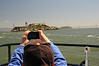 The Oakland Bay Bridge and Alcatraz Island.  The 22-acre island of Alcatraz was originally called Alcatraces, Spanish for the brown pelicans which used to populate The Rock.