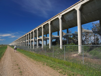 The road we are following was once a railway line.  Each 80 foot section of these giant concrete flumes are suspended between huge columns and girders.