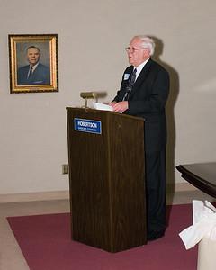 Arthur making speech at stockholders' meeting.