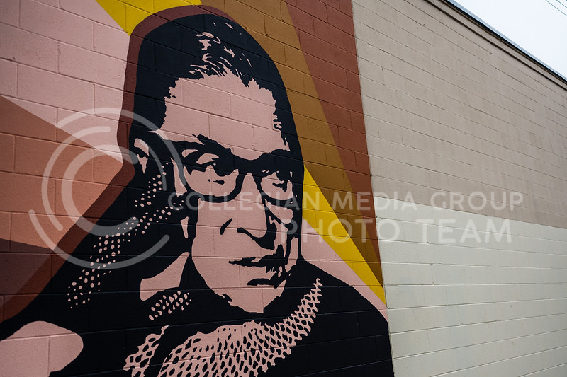 Local artists, Taylor Carr and Jessica Kerr painted the mural of Ruth Bader Ginsburg located downtown Manhattan in the alley between Poyntz and Houston. October 27, 2020. (Dylan Connell | Collegian Media Group)