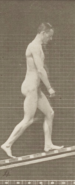 Nude man ascending an incline