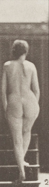 Nude woman ascending stairs