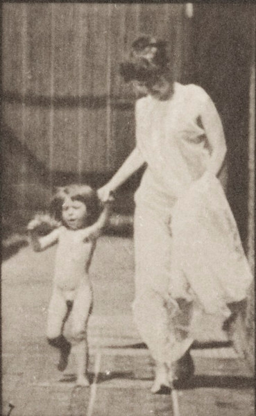 Semi-nude woman running and leading a naked child hand in hand