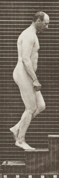 Nude man ascending stairs
