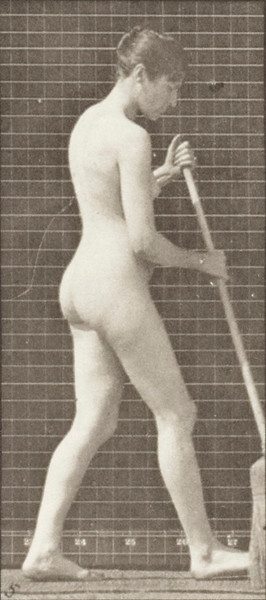 Nude woman walking, turning around, and sweeping the floor