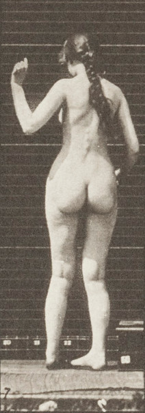 Nude woman turning, ascending stairs and waving hand