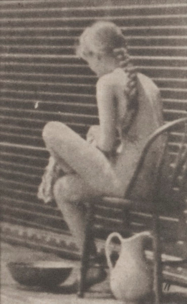 Nude woman sitting and wiping feet
