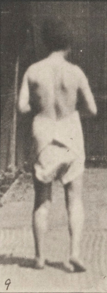 Semi-nude woman spastically walking