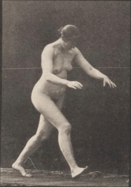 Nude woman stumbling