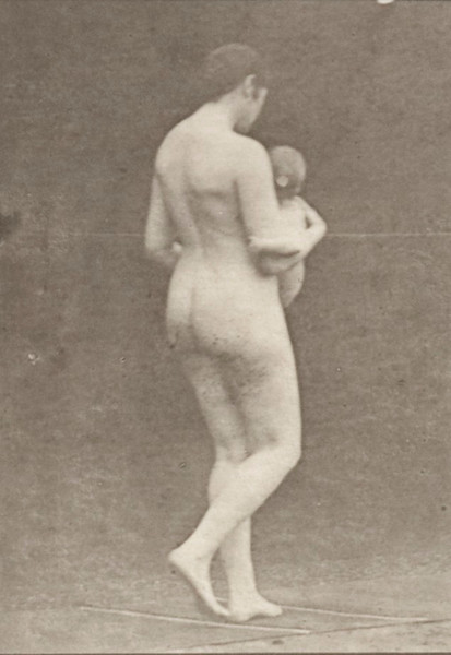 Nude woman carrying a child
