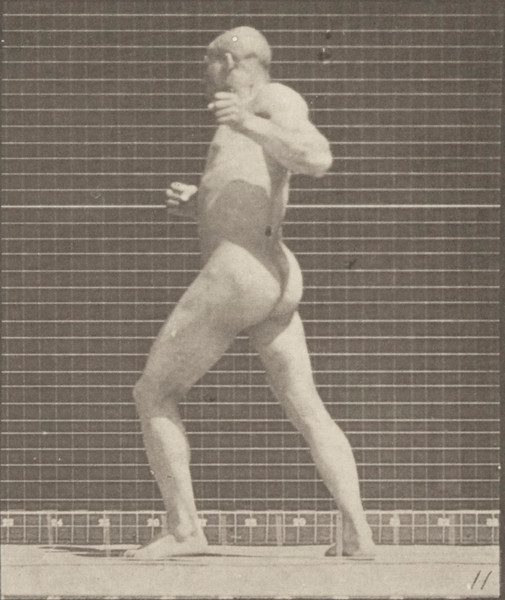Nude man striking a blow with left hand