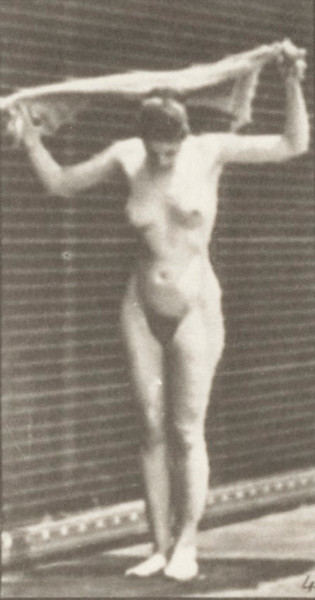 Nude woman drying body