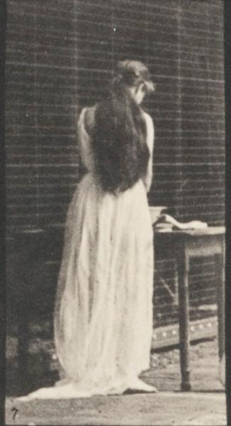 Woman brushing hair and washing face