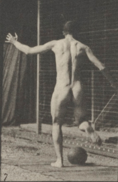 Nude man playing football, drop kick