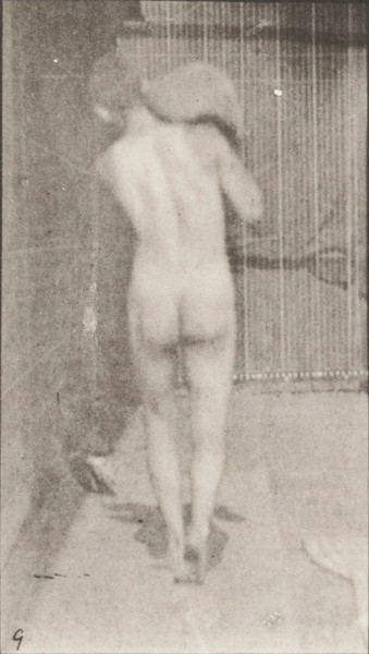 Nude man lifting a 75-lb. stone on shoulder