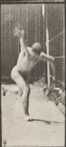 Nude man heaving a 20-lb. rock