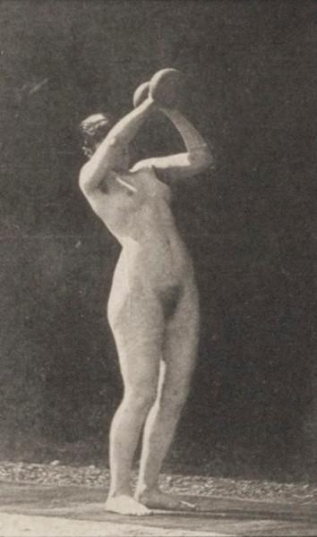 Nude woman lifting a 50-lb. dumbbell