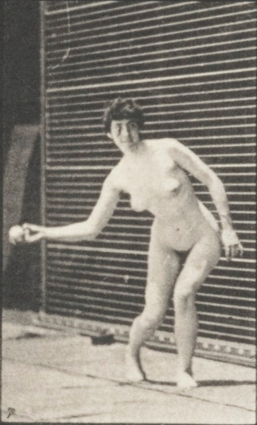 Nude woman picking up a ball and throwing it