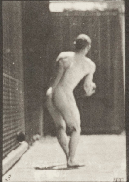 Nude man throwing an iron disk