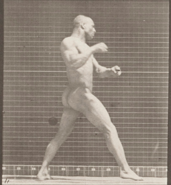 Nude man striking a blow with right hand